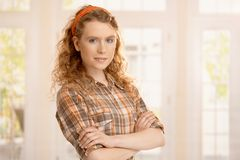 Portrait of pretty young girl at home smiling. Portrait of pretty young girl at home, smiling front of window stock photo