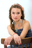 Portrait of a pretty young girl with long hair. Portrait of a pretty young girl with clean skin. Girl with long curly hairs. She sit on old chair Stock Photos