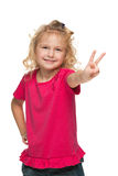 Pretty young girl makes a victory sign Stock Photography
