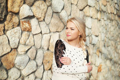 Portrait of a pretty young girl at  stone wall close up. Portrait  pretty young girl near stone wall Stock Images