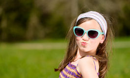 Portrait of a pretty young girl. With sunglasses Stock Image