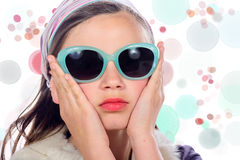 Portrait of a pretty young girl with sunglasses Royalty Free Stock Image