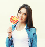 Portrait of pretty young girl with sweet lollipop Stock Photo