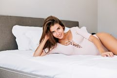 Free Portrait Pretty Young Girl With Long Hair  On White Bed. She Wears Sensual Clothes And Smiling To Camera. Stock Photography - 146049652