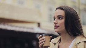 Portrait of Pretty Young Happy Girl Drinking Coffe Smiling Walking Relaxed Old City Background Close Up Slow Motion stock footage