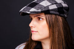 Portrait of a pretty young  lady with  cap Stock Image