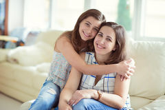 Portrait of pretty young mother with her tennager daughter Stock Photos