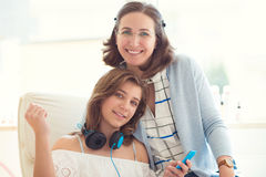 Portrait of pretty young mother with her tennager daughter Royalty Free Stock Photo