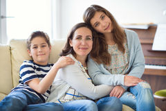 Portrait of pretty young mother with her tennager daughter and s. Portrait of pretty young mother with her two children adorable tennager daughter and son Royalty Free Stock Photography
