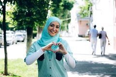Portrait of pretty young muslim woman on a street. royalty free stock photography