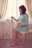 Portrait of pretty young pregnant woman Stock Photos