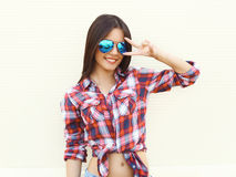 Portrait of pretty young slim woman in sunglasses having fun Stock Image