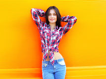 Portrait of pretty young slim woman wearing a checkered shirt Stock Photos
