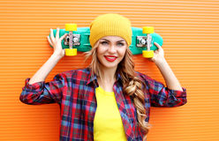 Portrait of pretty young smiling woman in red checkered hipster Royalty Free Stock Images