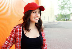 Portrait of pretty young smiling woman wearing shirt, cap Royalty Free Stock Photos
