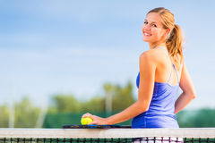 Portrait of a pretty young tennis player Stock Images