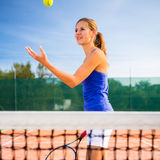 Portrait of a pretty young tennis player Stock Photo