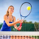 Portrait of a pretty young tennis player Stock Image