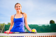 Portrait of a pretty young tennis player Royalty Free Stock Image
