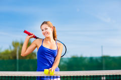Portrait of a pretty young tennis player Stock Photography