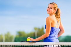 Portrait of a pretty young tennis player Royalty Free Stock Images