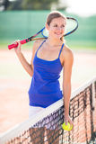Portrait of a pretty, young tennis player Stock Images