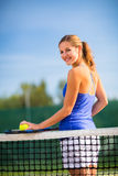 Portrait of a pretty, young tennis player  on  a court Royalty Free Stock Images