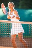 Portrait of a pretty young tennis player at play stock photography