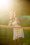 Portrait of a pretty young tennis player at play Stock Images