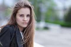 Portrait pretty young woman. Closeup portrait pretty young woman outdoors Royalty Free Stock Photo