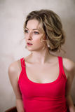 Portrait of pretty young woman against grunge background Royalty Free Stock Photos