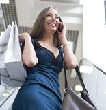 Portrait of pretty young woman with bags in the shop Stock Images