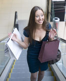 Portrait of pretty young woman with bags in the shop Royalty Free Stock Photos