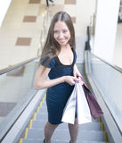 Portrait of pretty young woman with bags in the shop Royalty Free Stock Image