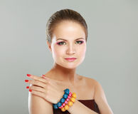Portrait of pretty young woman with bangle Royalty Free Stock Photography