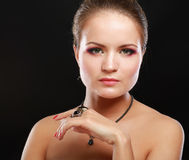 Portrait of pretty young woman with beads and Stock Photo