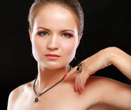 Portrait of pretty young woman with beads and Stock Image