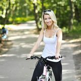 Portrait of pretty young woman with bicycle Stock Photo