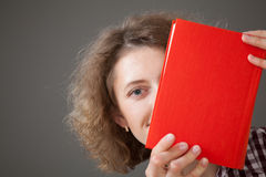 Portrait of a pretty young woman with a book Royalty Free Stock Image