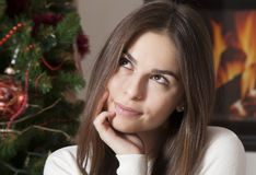 Portrait of pretty young woman in Christmas interior Stock Photography