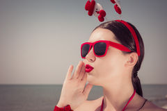 Portrait of a pretty young woman  in christmas themed outfit Royalty Free Stock Images