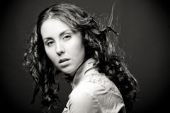 Portrait of pretty young woman with curly hair. Sepia tone Royalty Free Stock Photography