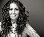 Portrait of pretty young woman with curly hair. Sepia tone Royalty Free Stock Photos