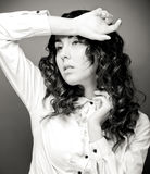 Portrait of pretty young woman with curly hair. Stock Photography