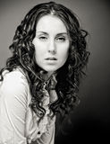 Portrait of pretty young woman with curly hair. Sepia tone Royalty Free Stock Images