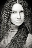 Portrait of pretty young woman with curly hair Royalty Free Stock Image
