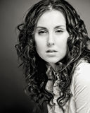 Portrait of pretty young woman with curly hair. Stock Images