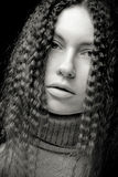 Portrait of pretty young woman with curly hair. Sepia tone Stock Images
