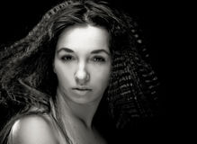 Portrait of pretty young woman with curly hair. Sepia tone Stock Photography