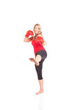 Portrait of pretty young woman doing boxing exercise Royalty Free Stock Image